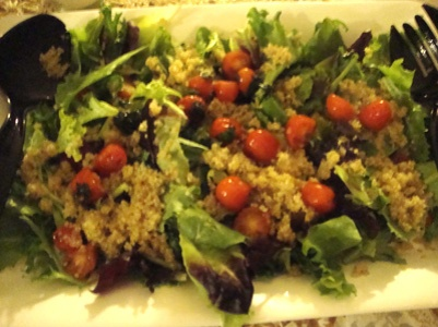quinoa and tomatoes over mixed greens